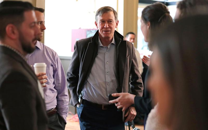 Former Democratic Colorado Governor John Hickenlooper arrives for a meeting with AmeriCorps members prior to a roundtable campaign stop in Manchester, N.H., Friday, March 22, 2019. Hickenlooper joined the 2020 Presidential race earlier in the month. (AP Photo/Charles Krupa)