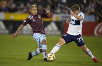 Colorado Rapids forward Michael Barrios, left, pursues the ball with Vancouver Whitecaps midfielder Ryan Gould in the first half of an MLS soccer match Sunday, Sept. 19, 2021, in Commerce City, Colo. (AP Photo/David Zalubowski)