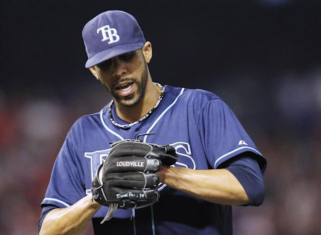 Tampa Bay Rays' David Price cheers between Texas Rangers batters during the sixth inning of an American League wild-card tiebreaker baseball game Monday, Sept. 30, 2013, in Arlington, Texas. (AP Photo/Tim Sharp)