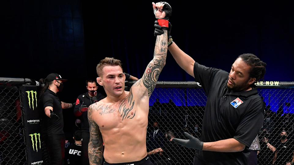 Seen here, Dustin Poirier celebrates his win against Conor McGregor.