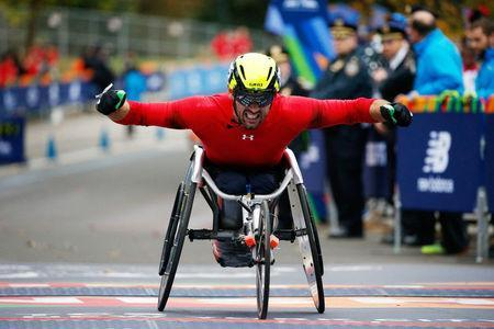John Charles Smith of Uinted Kingdom celebrates at the finish line of the New York City Marathon after winning the 2nd place in wheelchair race in Central Park in New York, U.S., November 5, 2017. REUTERS/Brendan McDermid