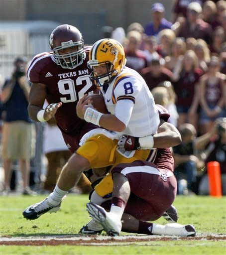 LSU quarterback Zach Mettenberger (8) his sacked by Texas A&M during the first half of their NCAA college football game, Saturday, Oct. 20, 2012, in College Station, Texas. (AP Photo/Eric Kayne)