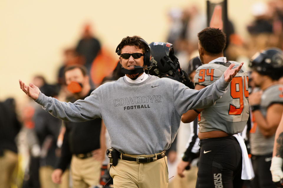 Oklahoma State head coach Mike Gundy gestures to an official during the last quarter of an NCAA college football game Saturday, Oct. 24, 2020, in Stillwater, Okla. (AP Photo/Brody Schmidt)