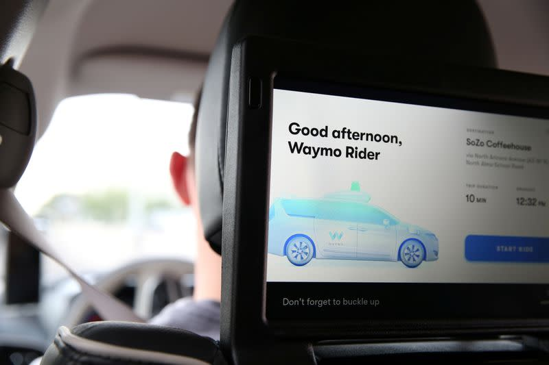 One of three screens displays the user interface inside a Waymo self-driving vehicle, during a demonstration in Chandler, Arizona