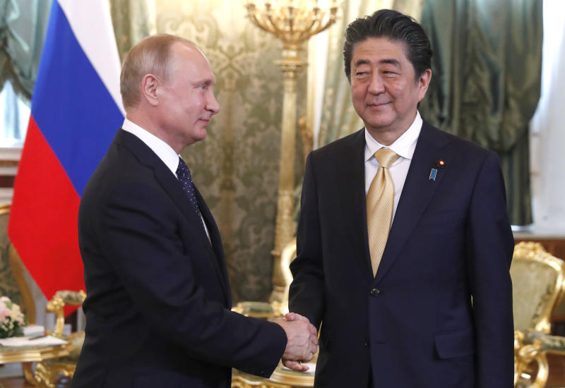 Japanese Prime Minister Shinzo Abe, right, shakes hands with Russian President Vladimir Putin during their meeting in Moscow, Russia, Saturday, May 26, 2018. (Grigory Dukor/Pool Photo via AP)