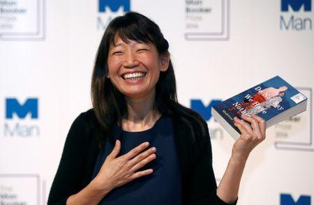 Author Madeleine Thien poses for photographs during a photo-call in London