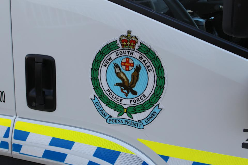 A stock image of a NSW Police Force logo on a vehicle.