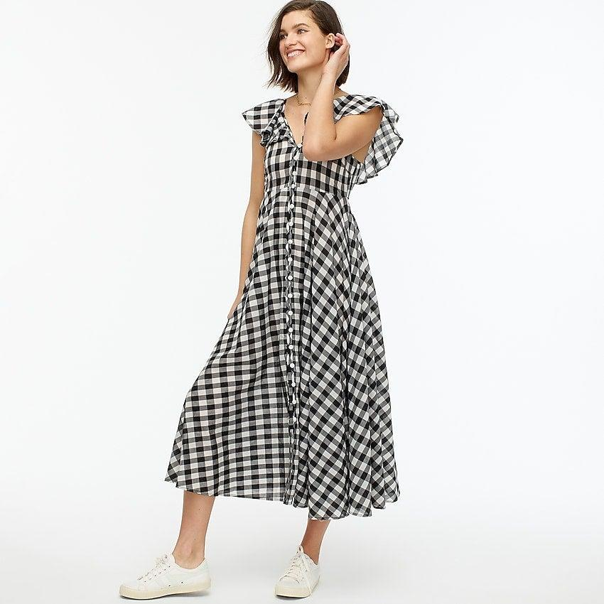 """<br><br><strong>J.Crew</strong> Button-up ruffle dress in gingham, $, available at <a href=""""https://go.skimresources.com/?id=30283X879131&url=https%3A%2F%2Fwww.jcrew.com%2Fp%2Fwomens%2Fcategories%2Fclothing%2Fdresses-and-jumpsuits%2Fbutton-up-ruffle-dress-in-gingham%2FAP047%3Fdisplay%3Dsale%26fit%3DClassic%26isFromSale%3Dtrue%26color_name%3Davril-gingham-ivory-bla%26colorProductCode%3DAP047"""" rel=""""nofollow noopener"""" target=""""_blank"""" data-ylk=""""slk:J. Crew"""" class=""""link rapid-noclick-resp"""">J. Crew</a>"""