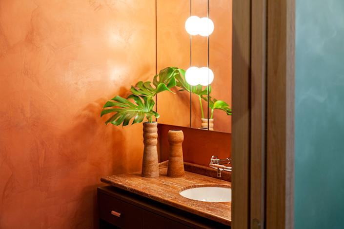 """<div class=""""caption""""> Two vases from Laura Fournier decorate the master bathroom where the tap is from <a href=""""https://usa.lefroybrooks.com/products/"""" rel=""""nofollow noopener"""" target=""""_blank"""" data-ylk=""""slk:Lefroy Brooks"""" class=""""link rapid-noclick-resp"""">Lefroy Brooks</a>. </div>"""