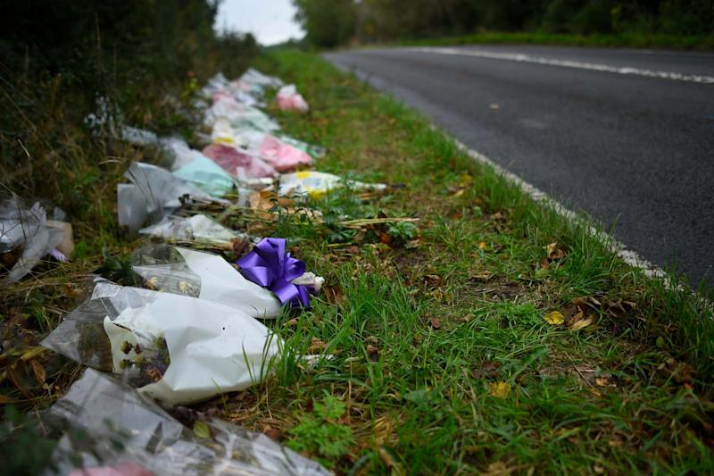 Tributes: flowers left at the scene of the crash (Getty Images)