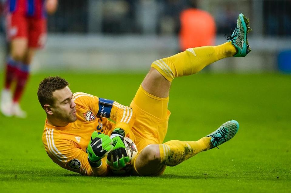 CSKA Moscow's goalkeeper Igor Akinfeev saves the ball during an UEFA Champions League group match against Bayern Munich, in Munich, southern Germany, in December 2014 (AFP Photo/Guenter Schiffmann)