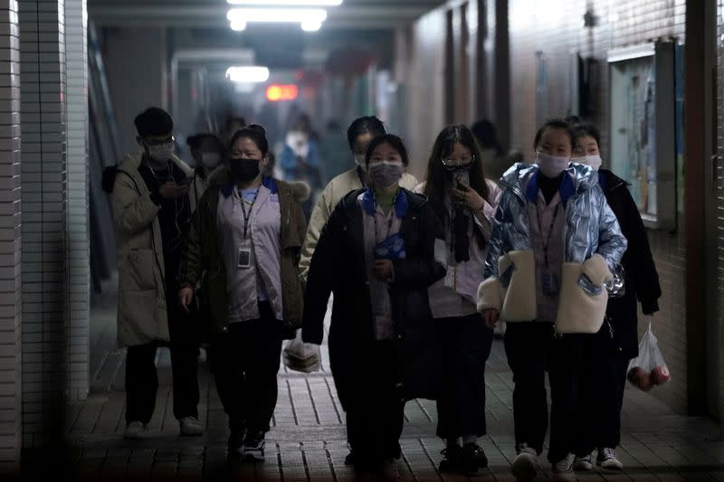 Slow return of China's migrant workers hobbles factory restarts