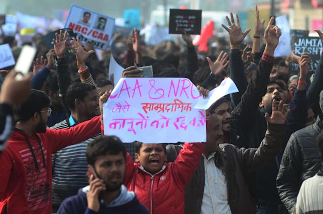 Protesters shout with placards during a demonstration against India's new citizenship law CAA ( Citizenship amandment Act ) in Allahabad on December 19,2019 . Indians defied bans nationwide as anger swells against a citizenship law seen as discriminatory against muslims, following days of protest, clashes, and riots that have left six dead .(Photo by Ritesh Shukla/NurPhoto via Getty Images)