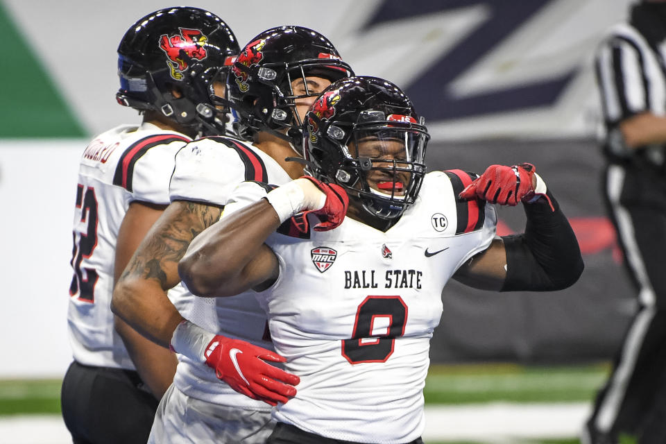 DETROIT, MICHIGAN - DECEMBER 18: Christian Albright #9 of the Ball State Cardinals celebrates after recovering a fumble for a touchdown against the Buffalo Bulls at Ford Field on December 18, 2020 in Detroit, Michigan. (Photo by Nic Antaya/Getty Images)