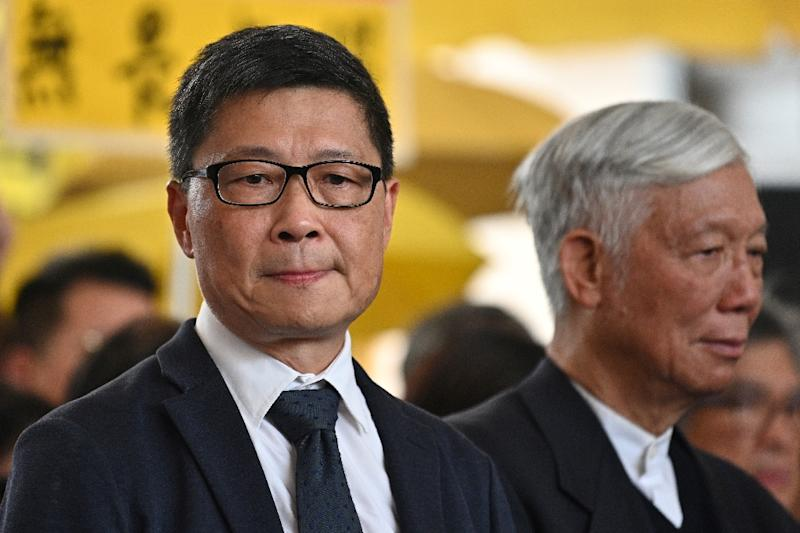 Sociology professor Chan Kin-man (L) and Baptist minister Chu Yiu-ming (R) were among Hong Kong activists convicted following a trial that has renewed alarm over shrinking freedoms under an assertive China (AFP Photo/Anthony WALLACE)