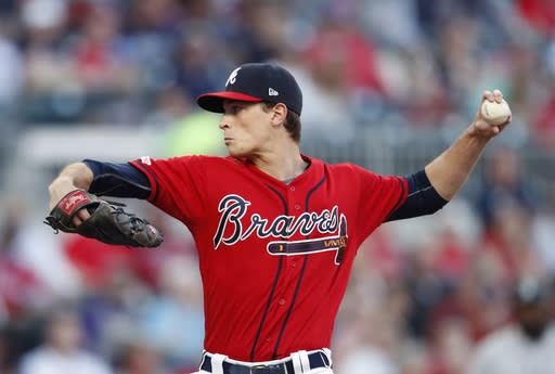 Atlanta Braves starting pitcher Max Fried works in the first inning of a baseball game against the Colorado Rockies, Friday, April 26, 2019, in Atlanta. (AP Photo/John Bazemore)