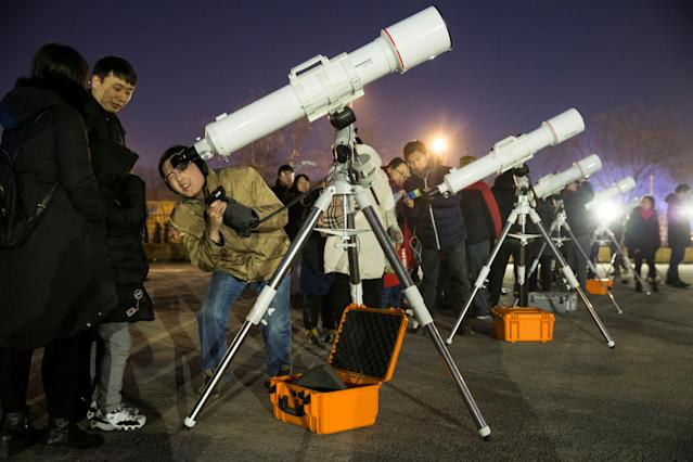 "<p>Skywatchers gather at Beijing Planetarium to watch a ""super blood blue moon"" eclipse with telescopes, in Beijing, China, Jan. 31, 2018. (Photo: China Daily via Reuters) </p>"