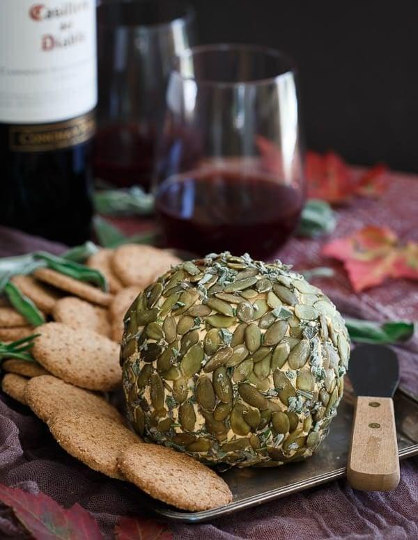 """<p>Make your appetizer table the hottest spot in the house when you add this cheese ball to the mix. Creamy mascarpone, cream cheese, cheddar, pumpkin, and fresh herbs make this satisfying app a dream come true. Crunchy crackers, warm bread, and seasonal veggies can all be dunked into it.</p> <p><strong>Get the recipe:</strong> <a href=""""https://www.runningtothekitchen.com/pumpkin-herb-cheese-ball/"""" class=""""link rapid-noclick-resp"""" rel=""""nofollow noopener"""" target=""""_blank"""" data-ylk=""""slk:pumpkin herb cheese ball"""">pumpkin herb cheese ball</a></p>"""