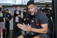 Tulsa linebacker Zaven Collins claps after completing the bench press during NFL football pro day Friday, April 2, 2021, in Tulsa, Okla. (AP Photo/Sue Ogrocki)