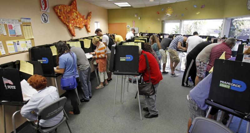 In this Nov. 3, 2012, file photo, South Floridians mark their ballots during the last day of early voting in Miami Beach, Fla. A judge extended early voting hours in one Florida county Sunday, Nov. 4, after Democrats sued to allow more time in a presidential battleground state where more than 4 million ballots have already been cast. The move was one of many legal skirmishes in the tight contest between Barack Obama and Mitt Romney to deal with inevitable disputes over balloting. Some Florida voters had stood in long lines Saturday, the last scheduled day of early voting. The judge ruled on a lawsuit filed late Saturday in Orange County after an early voting site was shut down for several hours. (AP Photo/Alan Diaz)