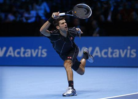 Djokovic of Serbia hits a return during his men's singles tennis match against Del Potro of Argentina at the ATP World Tour Finals in London
