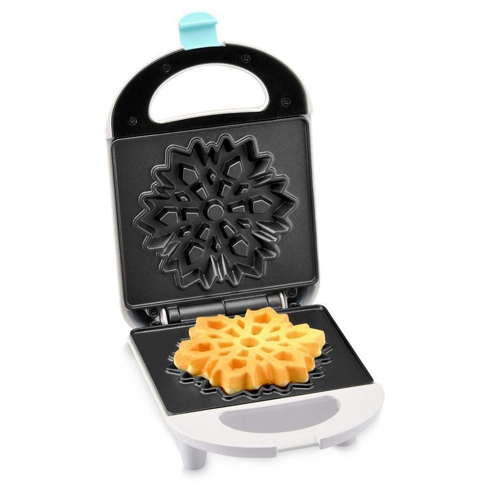 <p>They can make breakfast with the <span><strong>Frozen 2</strong> Snowflake Waffle Maker</span> ($20) before they go out and build a snowman.</p>