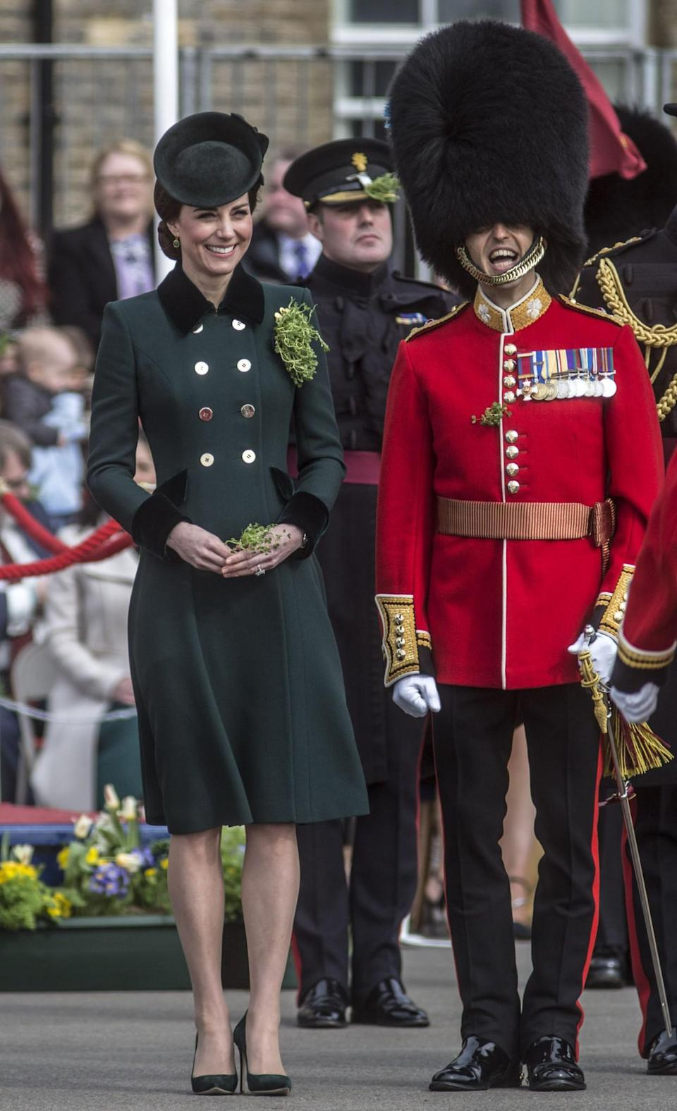 <p>Catherine Walker, the look featured gold military-style buttons. The Duchess paired the flattering design with green suede heels by Emmy London and a matching Sylvia Fletcher hat.<br><i>[Photo: PA]</i> </p>