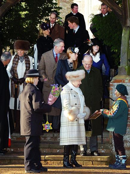 <p>The Queen (pictured with other members of her family, including her husband, son and several grandchildren) often opts for bright coats to make her easier to spot in a crowd, but this year, there was no missing that hat and cuffs. </p>