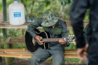 The anti-junta volunteers practice firing their homemade weapons, do physical training, and play guitar in between skirmishes with the military