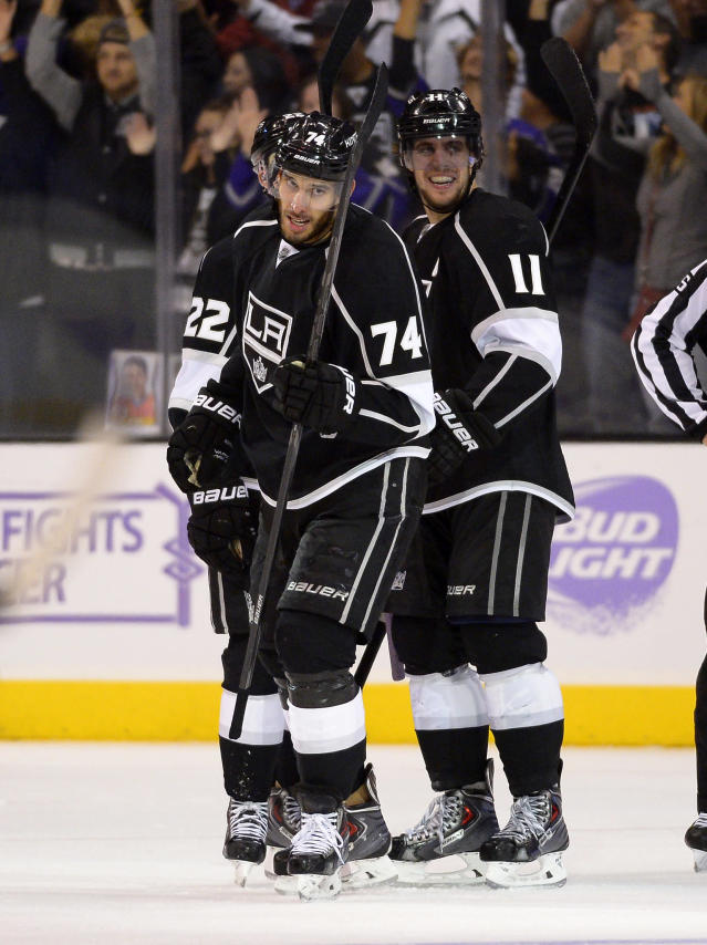 Los Angeles Kings center Dwight King, left, celebrates his third goal of the game with center Anze Kopitar, of Slovenia, during the third period of their NHL hockey game against the Phoenix Coyotes, Thursday, Oct. 24, 2013, in Los Angeles. (AP Photo/Mark J. Terrill)