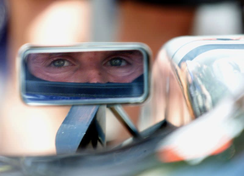 FILE PHOTO: McLaren-Mercedes' Scottish driver David Coulthard looks in his rear view mirror during the first free practice session of the Monaco Grand Prix in Monte Carlo.