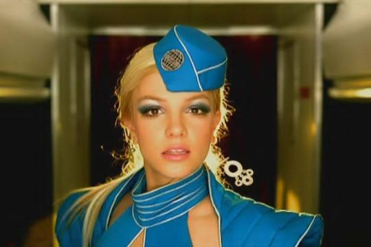 "<p>Another look from the ""Toxic"" video, this time, Spears goes full flight attendant with a super long ponytail and metallic eyeshadow. (Photo: YouTube)</p>"