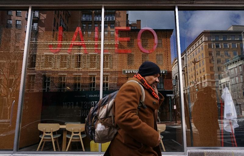 """Pedestrians pass by a restaurant closed for a """"Day Without Immigrants"""" in protest of US President Donald Trump's immigration policy, on February 16, 2017 in Washington, DC"""