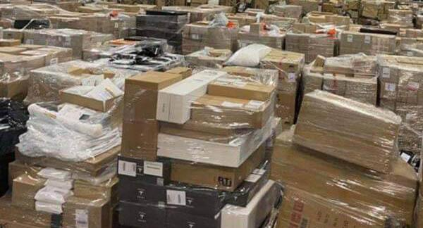 A shocking photo of an Australia Post distribution centre in Melbourne reveals the enormous backlog of parcels waiting to be delivered. Source: 3AW