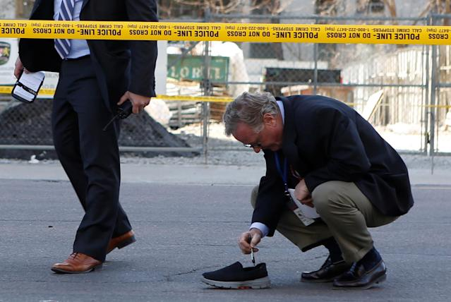 <p>A police detective investigates an incident where a van struck multiple people at a major intersection northern Toronto, Ontario, Canada, April 23, 2018. (Photo: Chris Donovan/Reuters) </p>