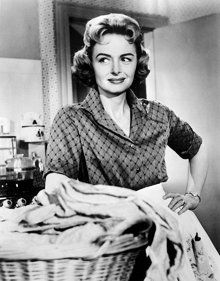 "<b>Donna Stone, ""The Donna Reed Show""</b>  <b>Signature Style:</b> Full-skirted shirtdresses and chic high heels -- for ironing and doing the vacuuming.  <b>Why We Love Her:</b> From 1958-1966, Donna Reed played the kind of coolly capable stay-at-home mother who's really only seen on television: Always impeccably turned out, she embodied a particular upper-middle-class ideal like no character before or since.   <a href=""http://www.instyle.com/instyle/package/general/photos/0,,20475181_20475183,00.html?xid=omg-10redheads?yahoo=yes"" target=""new"">The Top 10 Redheads in Hollywood</a> Everett Collection"