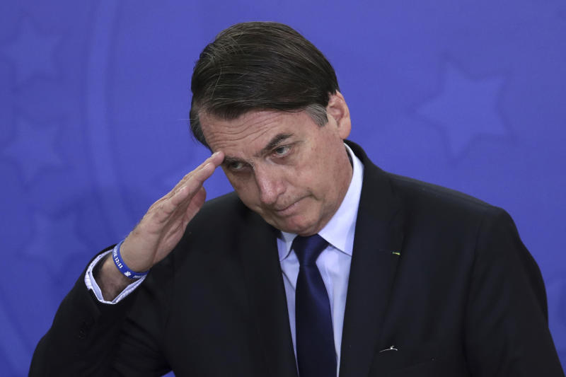 "Brazil's President Jair Bolsonaro salutes during a military promotion ceremony at the Planalto Presidential Palace, in Brasilia, Brazil, Friday, April 5, 2019. Bolsonaro, a former army captain who waxes nostalgic for the 1964-1985 military regime, caused a commotion in Brazil last week when he asked the Defense Ministry to organize ""due commemorations"" on March 31, a day historians call a coup that began the dictatorship. (AP Photo/Eraldo Peres)"