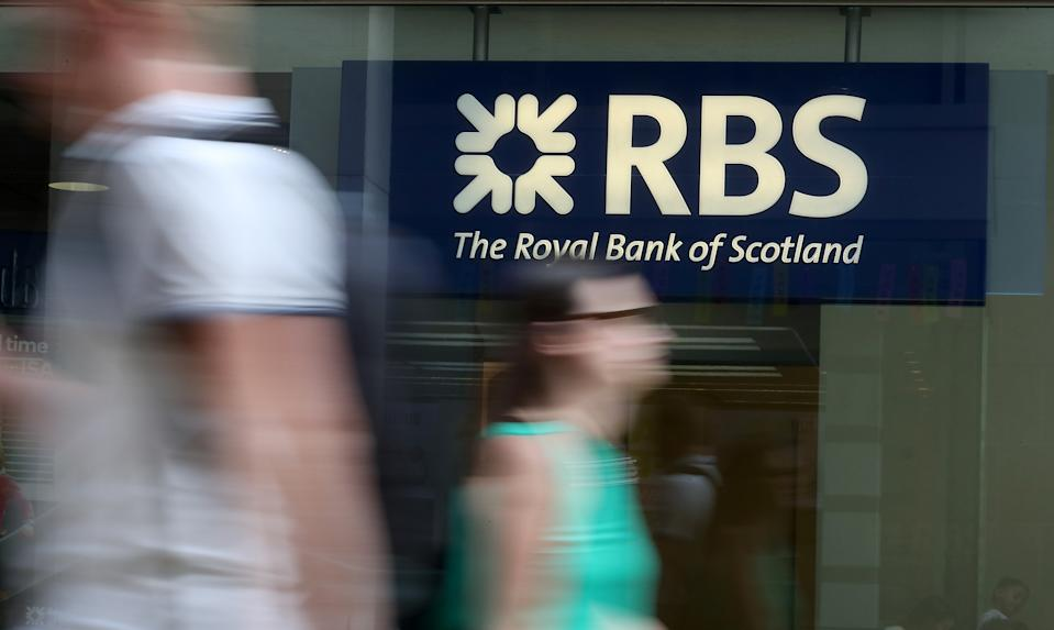 Pedestrians pass a branch of a Royal Bank of Scotland (RBS) bank branch in central London on July 25, 2018. (Photo by Daniel LEAL-OLIVAS / AFP)        (Photo credit should read DANIEL LEAL-OLIVAS/AFP/Getty Images)