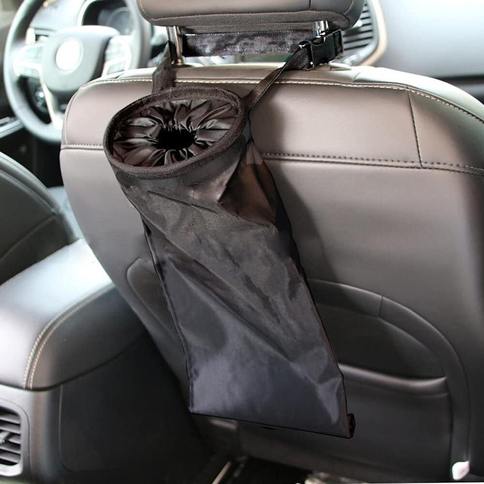 """This is sure to save the day (and your upholstery) from suckers, soda bottles and all the other sticky substances your kids sneak into the car. It turns out cupholders are, in fact,<i>not</i>tiny trash cans.<br /><br /><strong>Promising review:</strong>""""This is the most useful little item I have EVER placed in my car for litter management. It's easy to use, easy to empty, AND it doubles as a spare cup holder when needed. I've ordered more for our other cars.<strong>The kids have really improved their management of basic tidiness in the car with this in our family vehicle.</strong>My husband has managed to keep the passenger seat easy for me to join him in his car, and<strong>now our teens will enjoy an uncluttered life in the 'teen mobile</strong>.'"""" —<a href=""""https://amzn.to/3sl1XZ1"""" target=""""_blank"""" rel=""""nofollow noopener noreferrer"""" data-skimlinks-tracking=""""5902331"""" data-vars-affiliate=""""Amazon"""" data-vars-href=""""https://www.amazon.com/gp/customer-reviews/R1NKSZ1Z7C9FJ4?tag=bfmal-20&ascsubtag=5902331%2C21%2C37%2Cmobile_web%2C0%2C0%2C16540729"""" data-vars-keywords=""""cleaning"""" data-vars-link-id=""""16540729"""" data-vars-price="""""""" data-vars-product-id=""""20969100"""" data-vars-product-img="""""""" data-vars-product-title="""""""" data-vars-retailers=""""Amazon"""">DW</a><br /><br /><strong>Get it from Amazon for<a href=""""https://amzn.to/3aeJAik"""" target=""""_blank"""" rel=""""nofollow noopener noreferrer"""" data-skimlinks-tracking=""""5902331"""" data-vars-affiliate=""""Amazon"""" data-vars-asin=""""B01L5E7OB2"""" data-vars-href=""""https://www.amazon.com/dp/B01L5E7OB2?tag=bfmal-20&ascsubtag=5902331%2C21%2C37%2Cmobile_web%2C0%2C0%2C16540712"""" data-vars-keywords=""""cleaning"""" data-vars-link-id=""""16540712"""" data-vars-price="""""""" data-vars-product-id=""""17880049"""" data-vars-product-img=""""https://m.media-amazon.com/images/I/51poRQJmfRL._SL500_.jpg"""" data-vars-product-title=""""IPELY Universal Car Vehicle Back Seat Headrest Litter Trash Garbage Can (Black)"""" data-vars-retailers=""""Amazon"""">$7.99</a>.</strong>"""