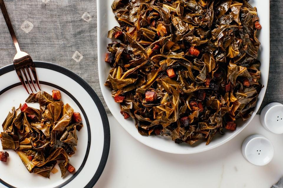 """Red wine vinegar brings brightness to this pile of slow-cooked greens while juicy bits of slab bacon bring balance…yeah, that's right, balance. <a href=""""https://www.epicurious.com/recipes/food/views/sauteed-collard-greens-with-slab-bacon?mbid=synd_yahoo_rss"""" rel=""""nofollow noopener"""" target=""""_blank"""" data-ylk=""""slk:See recipe."""" class=""""link rapid-noclick-resp"""">See recipe.</a>"""