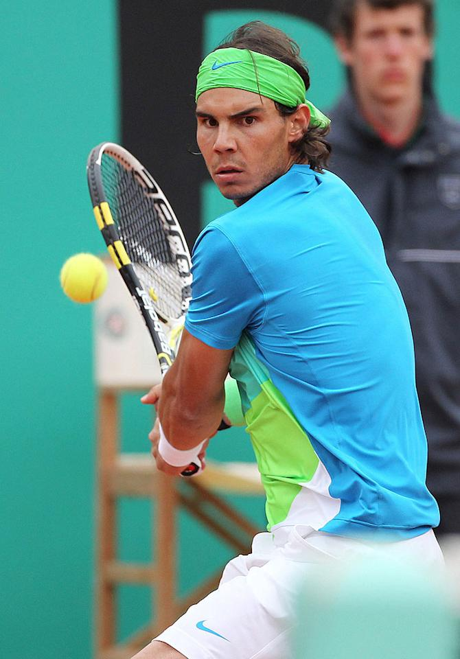 """In addition to being one of the sport's most talented stars, five-time French Open champion Rafael Nadal also happens to sport our favorite tennis ensemble. Love that color combo, Rafa! Juan Soliz/<a href=""""http://www.pacificcoastnews.com/"""" target=""""new"""">PacificCoastNews.com</a> - May 31, 2010"""