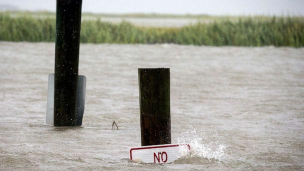 PHOTO: A sign at the Lazaretto Creek boat ramp as is nearly underwater at high tide as Hurricane Dorian makes its way up the east coast, Sept. 4, 2019, toward Tybee Island, Ga (Stephen B. Morton/AP)