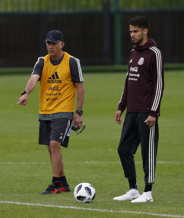 Mexico coach Juan Carlos Osorio gives instructions to Diego Reyes during a training session at the 2018 soccer World Cup in Moscow, Russia, Tuesday, June 12, 2018. (AP Photo/Eduardo Verdugo)