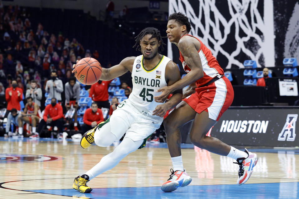 Davion Mitchell #45 of the Baylor Bears drives to the basket against Marcus Sasser #0 of the Houston Cougars in the second half during the 2021 NCAA Final Four semifinal at Lucas Oil Stadium on April 03, 2021 in Indianapolis, Indiana. (Photo by Tim Nwachukwu/Getty Images)