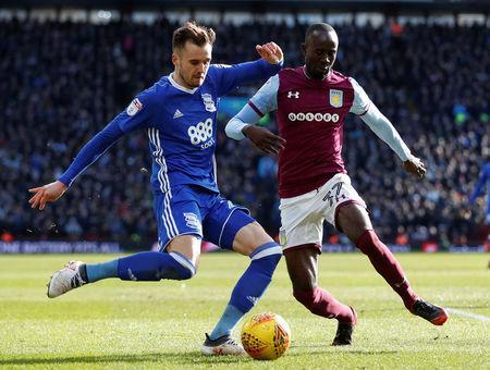 Soccer Football - Championship - Aston Villa vs Birmingham City - Villa Park, Birmingham, Britain - February 11, 2018 Aston Villa's Albert Adomah in action with Birmingham City's Carl Jenkinson Action Images/Matthew Childs