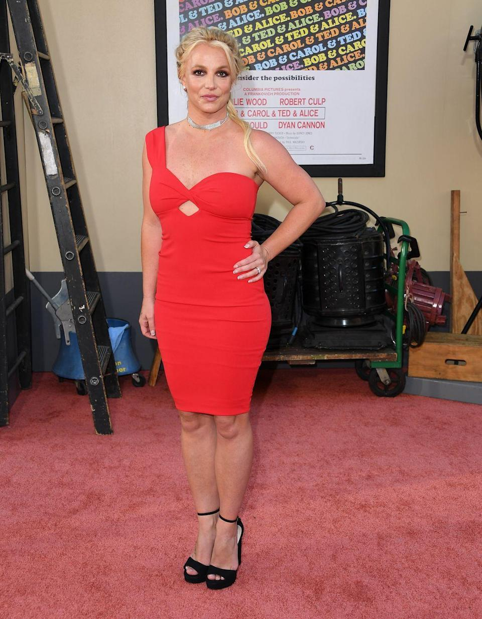 <p>Britney Spears wears an asymmetrical red dress for the premiere of <em>Once Upon A Time... In Hollywood</em> on July 22, 2019.</p>