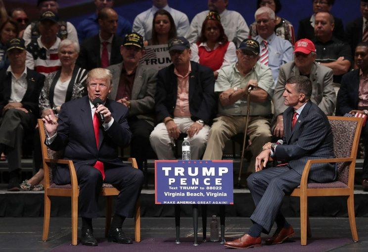 In September of last year, Donald Trump and Michael Flynn speak at a campaign event. (Photo: Alex Wong/Getty Images)