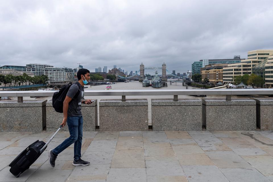 A man walks across London Bridge in London, Britain, Aug. 30, 2021. Another 26,476 people in Britain have tested positive for COVID-19, bringing the total number of coronavirus cases in the country to 6,757,650, according to official figures released Monday. (Photo by Ray Tang/Xinhua via Getty Images)