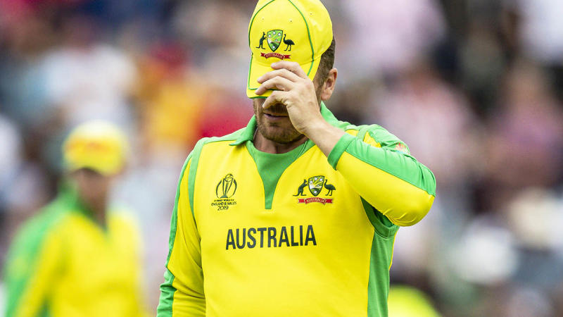 Aaron Finch couldn't look as the Aussies crashed out. (Photo by Andy Kearns/Getty Images)