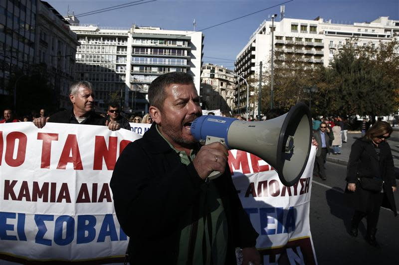 Protesters march during an anti-austerity rally against the government's plans for cutbacks in medical staff and hospitals in Athens